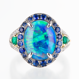 Black opal, sapphier, emerald and diamond ring